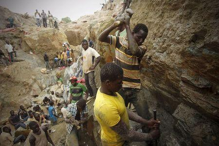 Prospectors search for gold at a gold mine near the village of Gamina, in western Ivory Coast, March 17, 2015. REUTERS/Luc Gnago