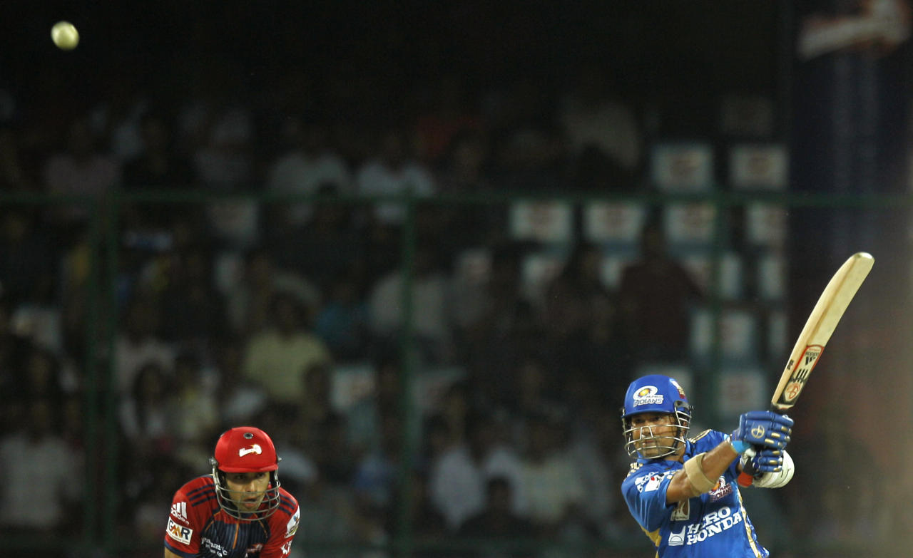 Mumbai Indians' Sachin Tendulkar, right, plays a shot for 6 during the Indian Premier League cricket match against Delhi Daredevils in New Delhi, India, Sunday, April 10, 2011. The fourth edition of the world's richest cricket tournament scheduled between April 8-May 28 comprises of 10 teams and 74 matches.