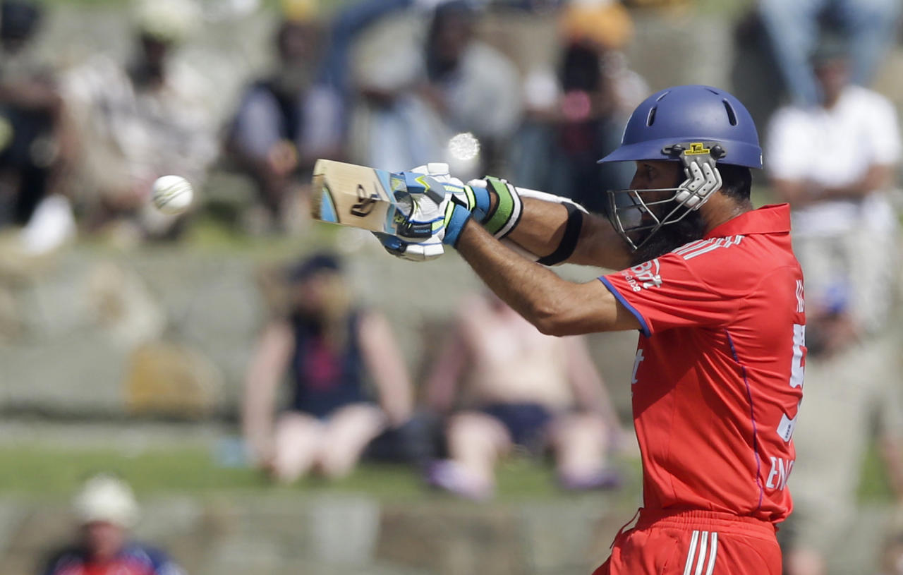 England's Moeen Ali plays a shot against West Indies during their first one-day international cricket match at the Sir Vivian Richards Cricket Ground in St. John's, Antigua, Friday, Feb. 28, 2014. (AP Photo/Ricardo Mazalan)