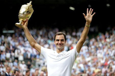 FILE PHOTO: Tennis - Wimbledon - London, Britain - July 16, 2017 Switzerland's Roger Federer poses with the trophy as he celebrates winning the 2017 final against Croatia's Marin Cilic REUTERS/Daniel Leal-Olivas/File Photo