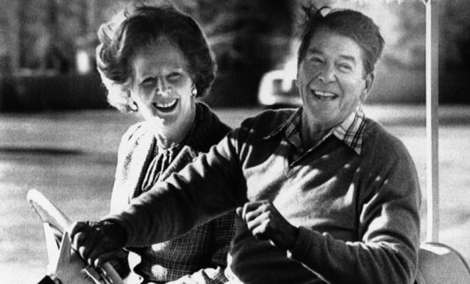 President Ronald Reagan and British Prime Minister Margaret Thatcher smile as they ride an electric cart at Camp David, Md., on Dec. 22, 1984.