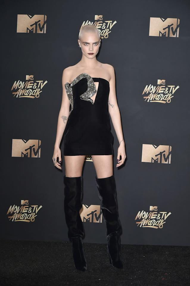 <p>Cara Delevingne was sultry in Saint Laurent. (Photo: Getty Images) </p>