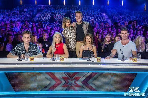 Bye bye Louis: Nick Grimshaw and Rita Ora replace Louis and Mel, as they join Simon and Cheryl on the panel. Meanwhile, Caroline Flack and Olly Murs step into Dermot O'Leary's shoes as host.