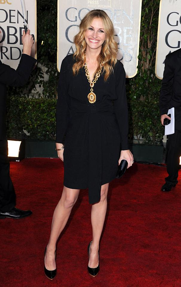 "Worst office casual: Julia Roberts In 2010, Julia Roberts wore a 1972 Van Cleef & Arpels 18K gold sautoir, studded with 29 citrines and diamonds. The little black dress was meh, even if it was a vintage Yves Saint Laurent wool crepe. Meh downgrades into worst category when you consider that she's reached the status of Hollywood Legend (no matter what you think of her performance in ""Larry Crowne"") and she was presenting the best picture award. Surely the Navis deserved better."