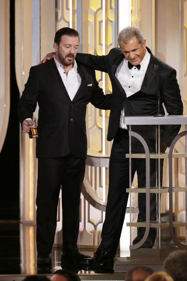 Host Ricky Gervais and presenter Mel Gibson speak onstage during the 73rd Annual Golden Globe Awards at The Beverly Hilton Hotel, 2016. (Paul Drinkwater/NBCUniversal via Getty Images)