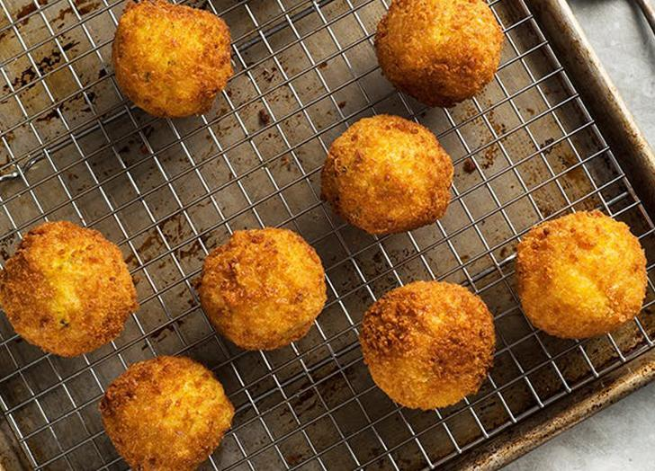 """<h2>22. Vegan Arancini</h2> <p>Made with leftover risotto and vegan """"cheese,"""" they're easy to whip up and even easier to devour.</p> <p><a class=""""link rapid-noclick-resp"""" href=""""https://www.purewow.com/recipes/vegan-arancini"""" rel=""""nofollow noopener"""" target=""""_blank"""" data-ylk=""""slk:Get the recipe"""">Get the recipe</a></p>"""