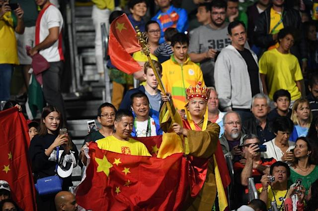 Fans watch the men's singles final gold medal table tennis match between China's Ma Long and compatriot Zhang Jike at the Rio 2016 Olympic Games (AFP Photo/Jim Watson)