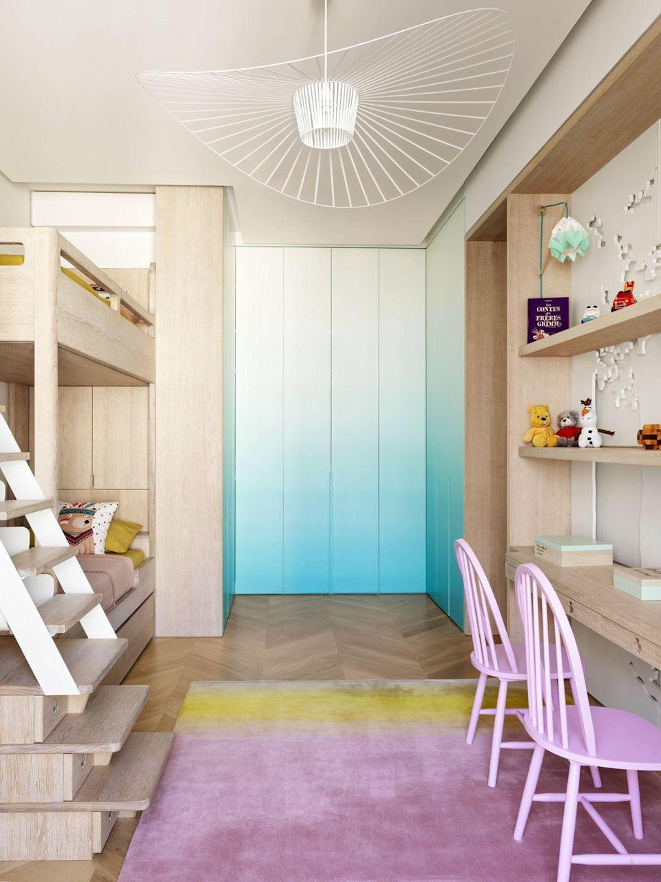 """<p>Ombre walls, pastel chairs, and eye-catching rugs (Han Feng for <a href=""""https://www.taipingtent.com"""" rel=""""nofollow noopener"""" target=""""_blank"""" data-ylk=""""slk:Tai Ping"""" class=""""link rapid-noclick-resp"""">Tai Ping</a>) establish a creativity hub for children to play and dream within this <a href=""""https://www.veranda.com/home-decorators/a30145144/le-berre-vevaud-paris-apartment/"""" rel=""""nofollow noopener"""" target=""""_blank"""" data-ylk=""""slk:Paris bedroom"""" class=""""link rapid-noclick-resp"""">Paris bedroom</a> designed by <a href=""""https://leberrevevaud.com"""" rel=""""nofollow noopener"""" target=""""_blank"""" data-ylk=""""slk:Le Berre Vevaud"""" class=""""link rapid-noclick-resp""""> Le Berre Vevaud</a>. The walls are lacquered in various shades of aqua for a playful tie-dye effect. </p>"""