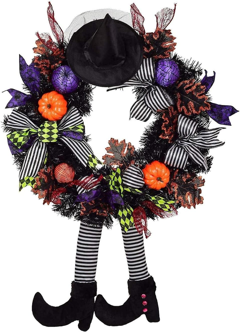 """<p>Instill your room with cute witchy vibes with this festive <span>KCOTO Witch Halloween Wreath</span> ($16, originally $17). If you want to stay spooky when the holidays arrive, simply reuse this and <a href=""""http://www.popsugar.com/family/Christmas-Decorating-Earlier-Makes-You-Happier-44282312"""" class=""""link rapid-noclick-resp"""" rel=""""nofollow noopener"""" target=""""_blank"""" data-ylk=""""slk:add Christmas goodies"""">add Christmas goodies</a> like mistletoe and holly.</p>"""