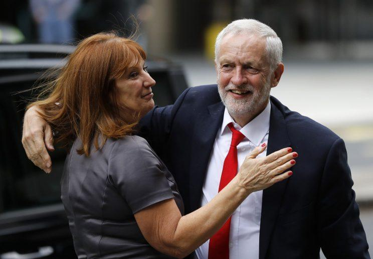Labour leader greeted by a well-wisher (Rex)