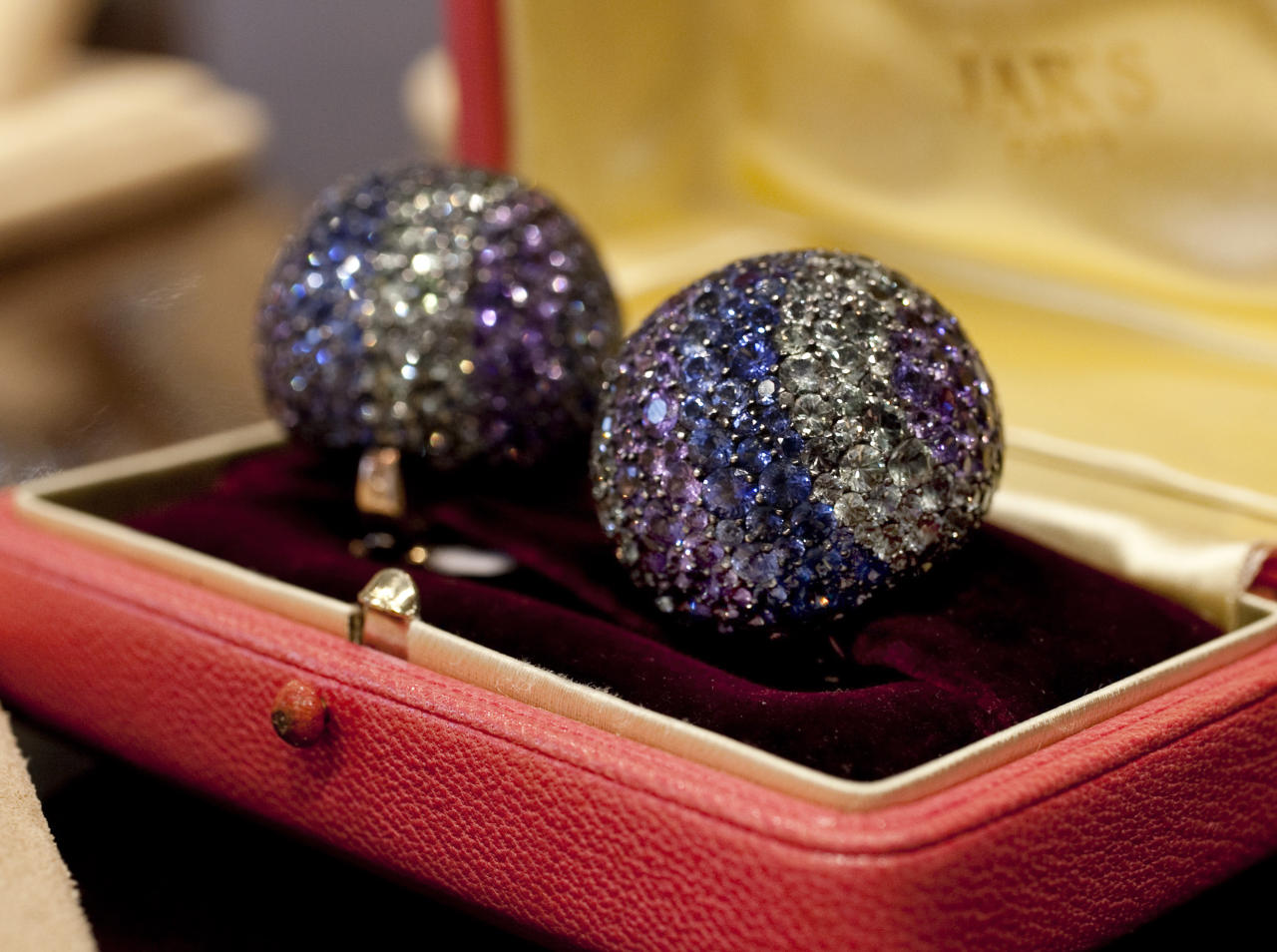 "Elizabeth Taylor's diamond and multi-colored sapphire ""Ball"" ear clips, from JARS, estimated at $100,000 - $150,000, are shown in this photograph at Christie's, in New York, Thursday, Sept. 1, 2001. Christie's auction house is selling her complete jewelry collection in New York on Dec. 13-14. (AP Photo/Richard Drew)"