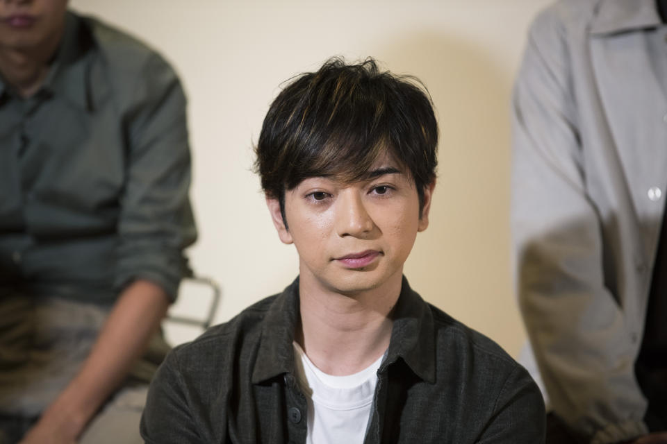 Jun Matsumoto, a member of Japanese pop music band ARASHI, listens to a question during an interview with The Associated Press in Tokyo on Thursday, Sept. 17, 2020. (AP Photo/Hiro Komae)