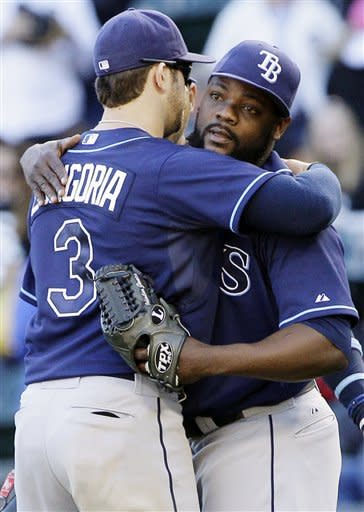 Tampa Bay Rays closer Fernando Rodney, right, celebrates with Evan Longoria after the Rays defeated the Chicago White Sox 6-2 in a baseball game in Chicago, Sunday, Sept. 30, 2012. (AP Photo/Nam Y. Huh)