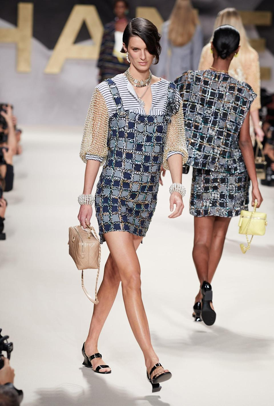 <p>Between the pearl-beaded balloon sleeves and the denim take on chainmail (denimmail?), this is all very interesting.</p>