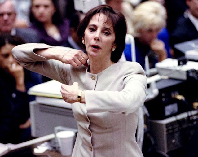 <p>Prosecutor Marcia Clark demonstrates for the jury how the murders of Nicole Simpson and Ronald Goldman were committed as she presents her closing arguments Sept. 26, 1995 at O.J. Simpson's murder trial. (Photo: Pool/Reuters) </p>