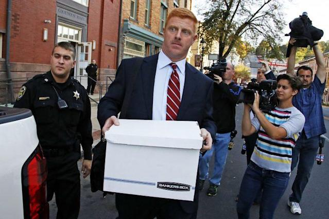 Mike McQueary was awarded more than $12 million in damages in two lawsuits against Penn State. (Getty Images)