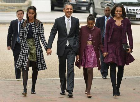 U.S. President Obama his family walk from the White House to St. John's Church for Sunday services, in Washington