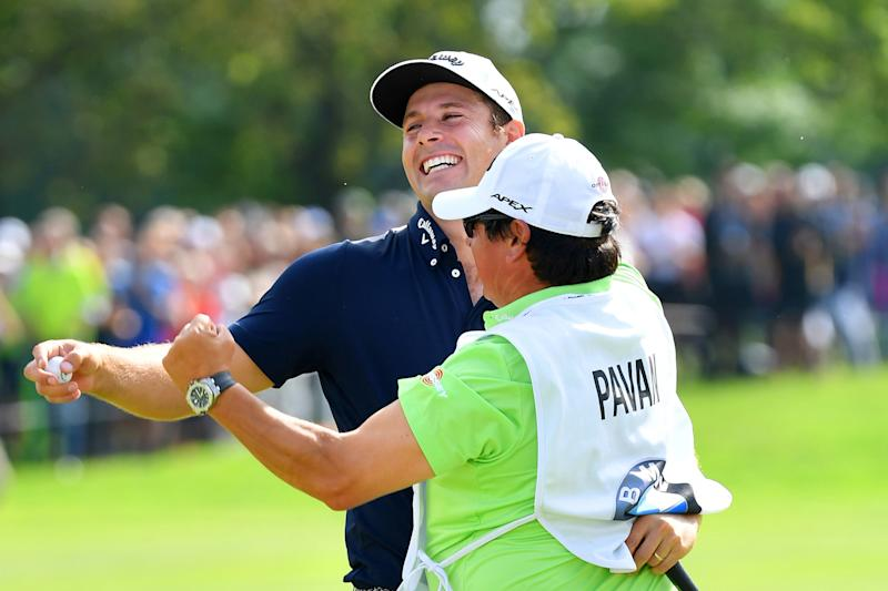 Andrea Pavan celebrates with his caddie on the 18th green after his victory during a playoff at the 2019 BMW International Open.