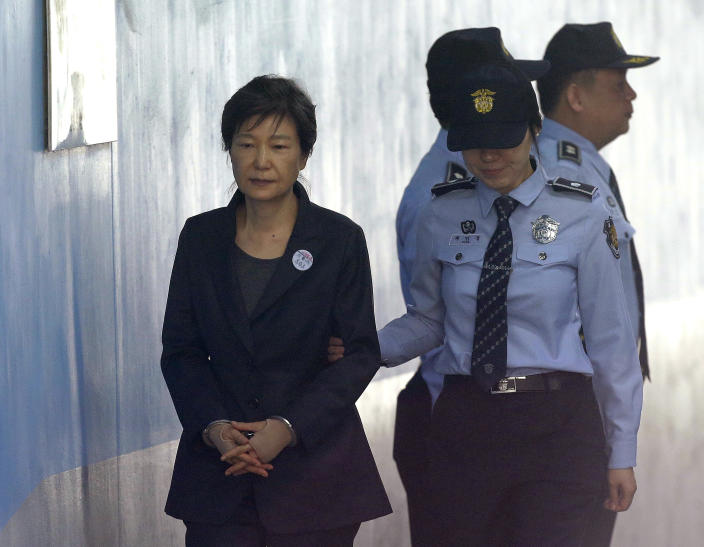 FILE - In this Oct. 10, 2017, file photo, former South Korean President Park Geun-hye, left, arrives to attend a hearing on the extension of her detention at the Seoul Central District Court in Seoul, South Korea. South Korea's top court upheld 20-year prison term for Park over corruption on Thursday, Jan. 14, 2021. (AP Photo/Ahn Young-joon, File)