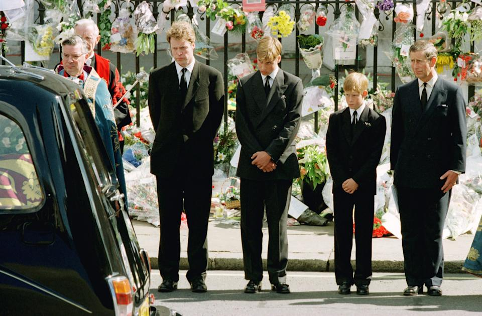 Prince Charles (R) with his two sons Prince Harry (2ndR) and Prince William (3rdR) and Diana's brother Earl Spencer bow their heads as they watch the hearse bearing the coffin of Diana, Princess of Wales leave Westminster Abbey, September 6.  Over a million mourners lined the route of the funeral procession through London.