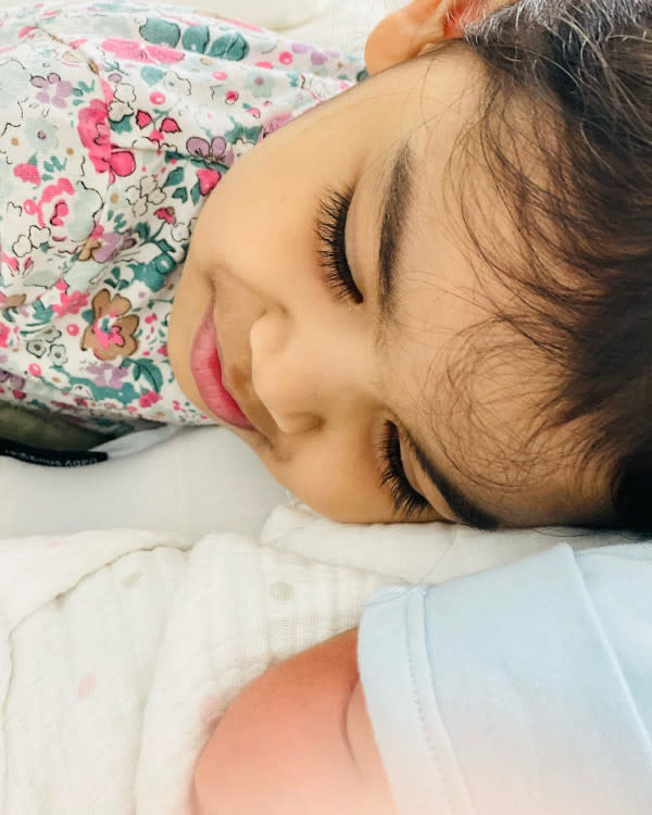 Siti's daughter Aafiyah with her new baby brother