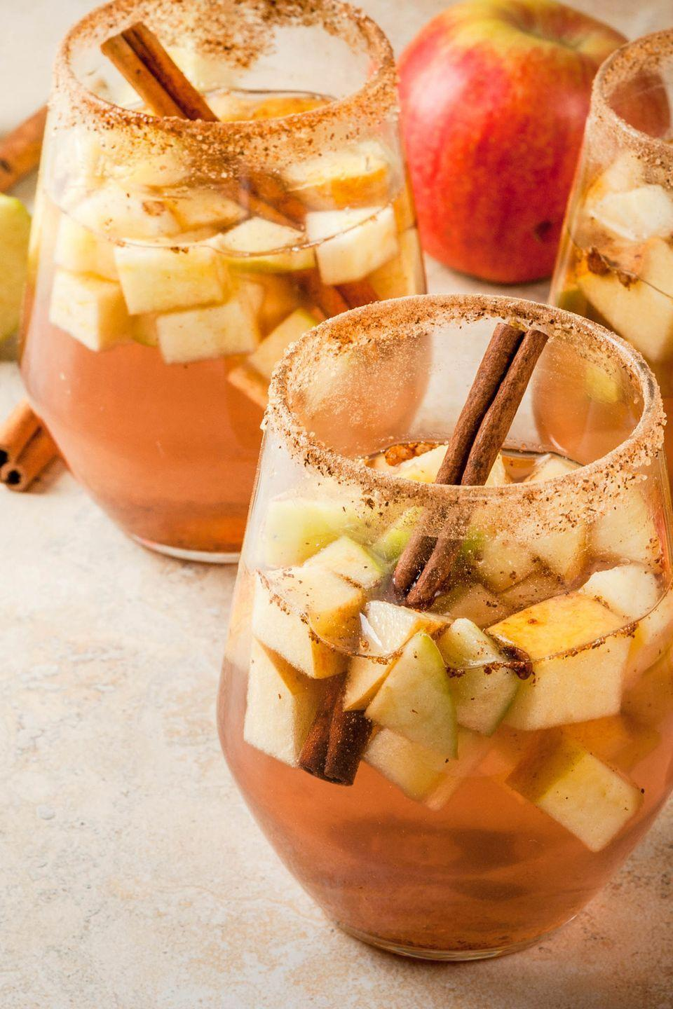 "<p>Cider, caramel, cinnamon, apple, and more! <a href=""http://www.countryliving.com/food-drinks/g3719/fall-sangria-recipes/"" rel=""nofollow noopener"" target=""_blank"" data-ylk=""slk:These tasty sangria recipes"" class=""link rapid-noclick-resp"">These tasty sangria recipes</a> feature all the best fall flavors and make the perfect cocktail for fall parties.</p><p><a class=""link rapid-noclick-resp"" href=""https://www.amazon.com/Hiware-Pitcher-Stainless-Beverage-Homemade/dp/B00ICZI5I4/?tag=syn-yahoo-20&ascsubtag=%5Bartid%7C10050.g.2633%5Bsrc%7Cyahoo-us"" rel=""nofollow noopener"" target=""_blank"" data-ylk=""slk:SHOP PITCHERS"">SHOP PITCHERS</a> </p>"