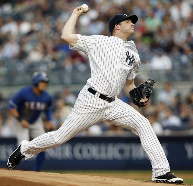 With Texas Rangers Shin Soo-Choo on first base, New York Yankees starting pitcher Chase Whitley delivers in a baseball game at Yankee Stadium in New York, Tuesday, July 22, 2014. (AP Photo)