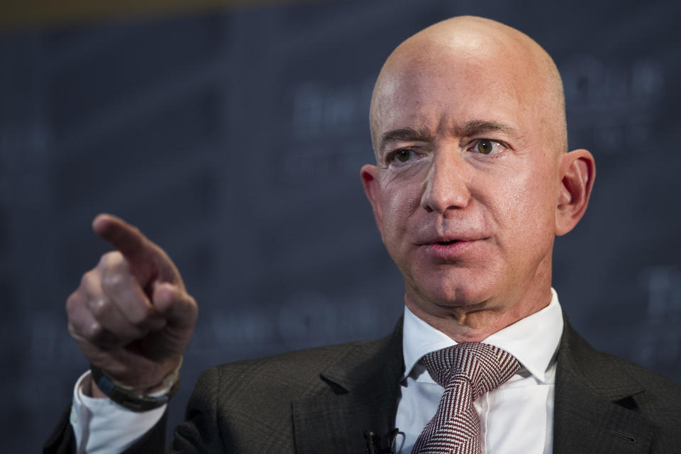 Jeff Bezos, the world's richest person, earns more in one hour than most make in a year. (AP Photo/Cliff Owen)