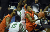 Oregon State guard Gianni Hunt (0) drives to the basket past Oregon forward Eugene Omoruyi (2) during the first half of an NCAA college basketball game Saturday, Jan. 23, 2021, in Eugene, Ore. (AP Photo/Andy Nelson)
