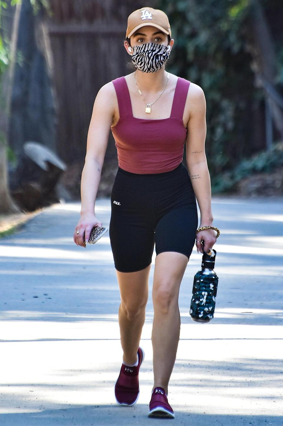 <p>A masked Lucy Hale goes for a hike in Los Angeles on Thursday.</p>