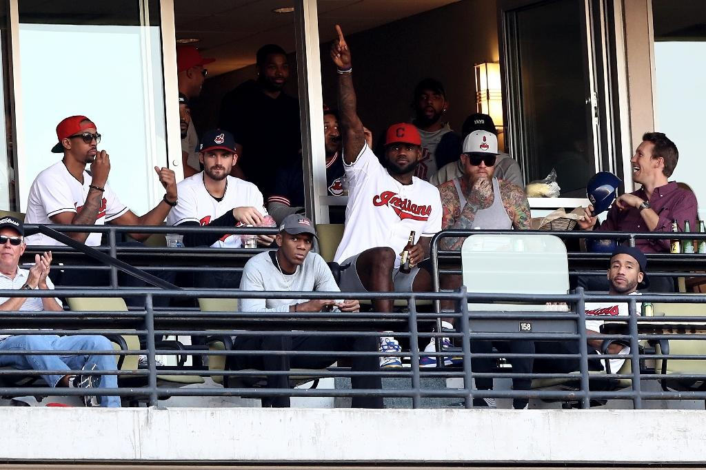 LeBron James (C) has been a very public supporter of the Cleveland Indians baseball team (AFP Photo/Elsa)