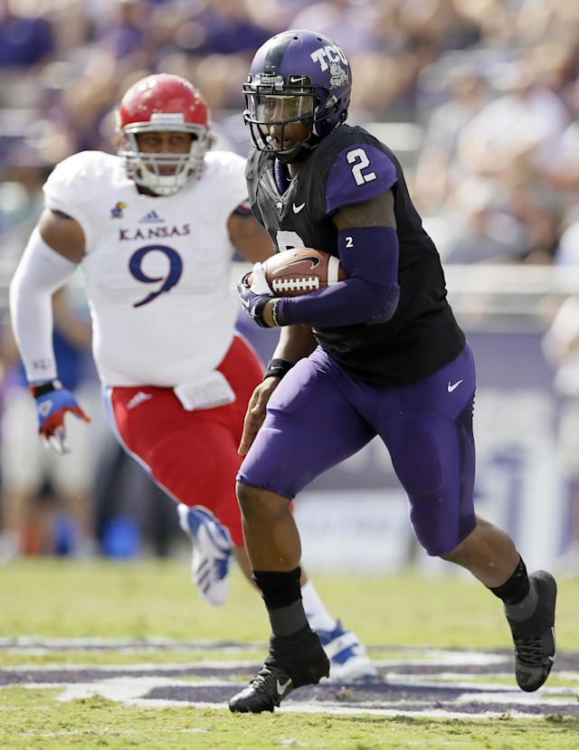 TCU quarterback Trevone Boykin (2) keeps the ball on a running play as Kansas' Jordan Tavai (9) gives chase in the first half of an NCAA college football game, Saturday, Oct. 12, 2013, in Fort Worth, Texas. (AP Photo/Tony Gutierrez)