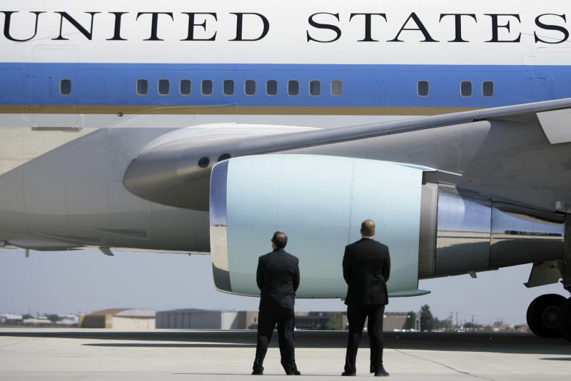 In this Saturday, Oct. 4, 2008 photo, Secret Service agents watch as Air Force One departs Midland International Airport with President Bush and first lady Laura Bush aboard in Midland, Texas. The Secret Service has been tarnished by a prostitution scandal that erupted April 13, 2012 in Colombia involving 12 Secret Service agents, officers and supervisors and 12 more enlisted military personnel ahead of President Barack Obama's visit there for the Summit of the Americas. (AP Photo/Matt Slocum)