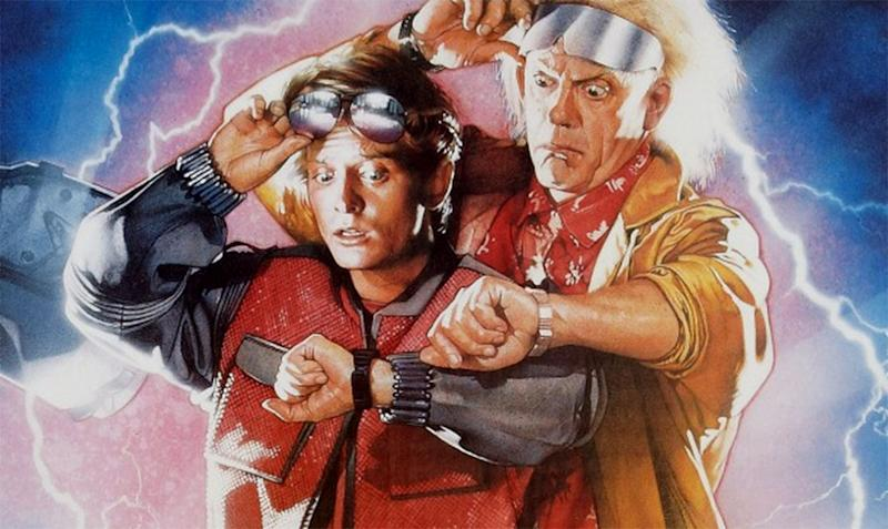 Michael J Fox and Christopher Lloyd on the 'Back To The Future Part II' poster - Credit: Universal Pictures