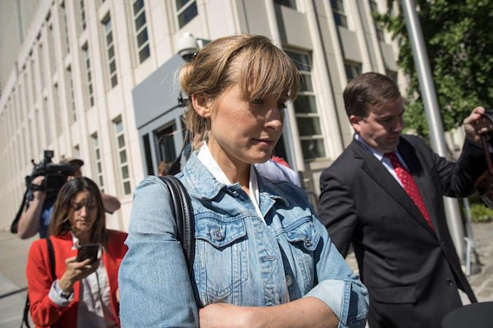 Actress Allison Mack exits the U.S. District Court for the Eastern District of New York following a status conference, June 12, 2018 in the Brooklyn borough of New York City