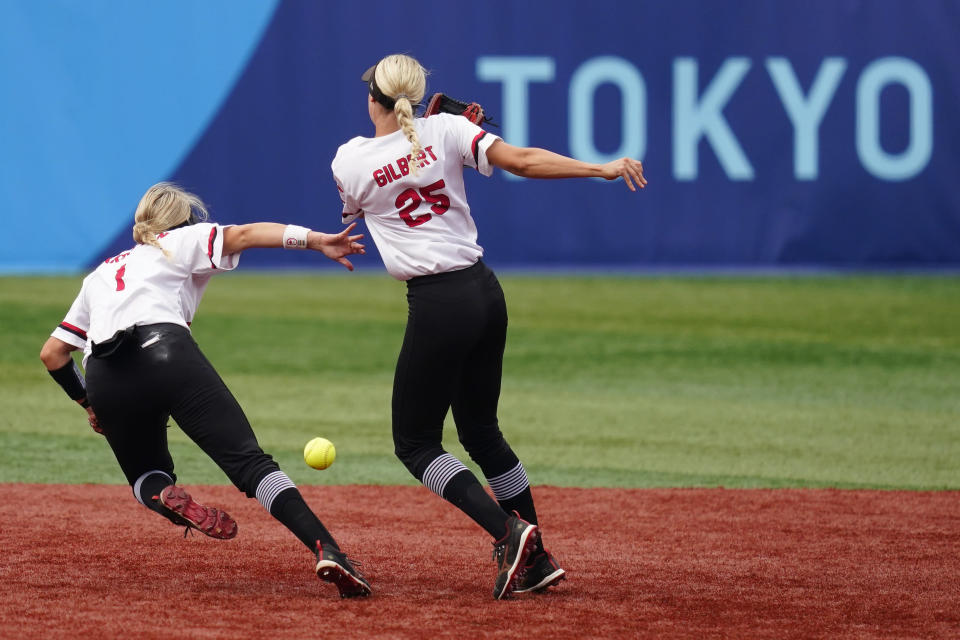 Canada's Kelsey Harshman, left, and Jennifer Gilbert collide while trying to catch a pop up during a softball game against Italy at Yokohama Baseball Stadium during the 2020 Summer Olympics, Monday, July 26, 2021, in Yokohama, Japan. (AP Photo/Matt Slocum)