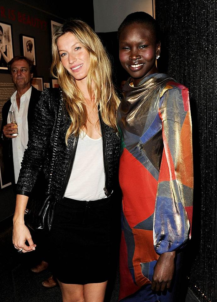 "Models Gisele Bundchen (who left hubby Tom Brady and baby Benjamin at home!) and Alek Wek perused the walls of the exhibit, which include Gisele herself. Kevin Winter/<a href=""http://www.gettyimages.com/"" target=""new"">GettyImages.com</a> - May 19, 2011"