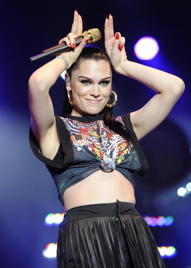 Celebrity photos: Jessie J has performed a string of gigs recently, pulling her trademark bunny rabbit ear pose. Whilst we loved her on The Voice, we're loving seeing her back on stage where she belongs. Copyright [Rex]