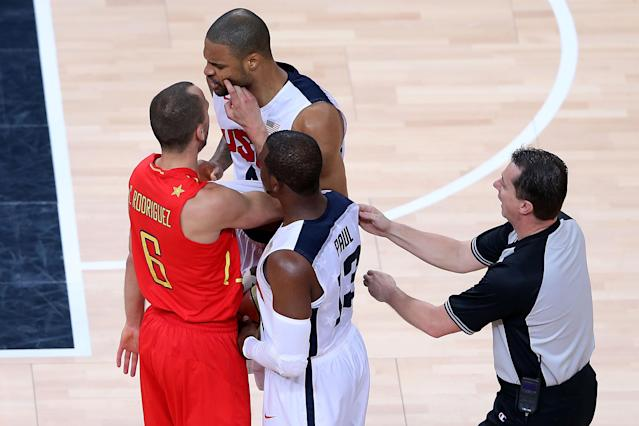 LONDON, ENGLAND - AUGUST 12: Tyson Chandler #4 of the United States reacts after clashing with Sergio Rodriguez #6 of Spain during the Men's Basketball gold medal game between the United States and Spain on Day 16 of the London 2012 Olympics Games at North Greenwich Arena on August 12, 2012 in London, England. (Photo by Streeter Lecka/Getty Images)