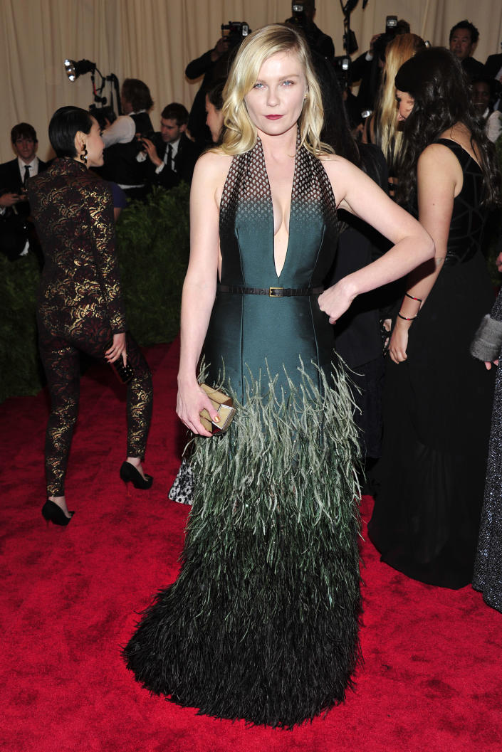 """Kirsten Dunst attends The Metropolitan Museum of Art's Costume Institute benefit celebrating """"PUNK: Chaos to Couture"""" on Monday, May 6, 2013, in New York. (Photo by Charles Sykes/Invision/AP)"""