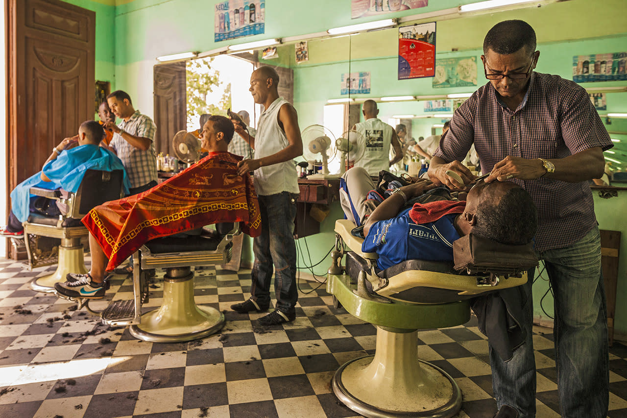 <p>Barber chairs are all occupied at this barbershop in Camagüey, Cuba. </p>