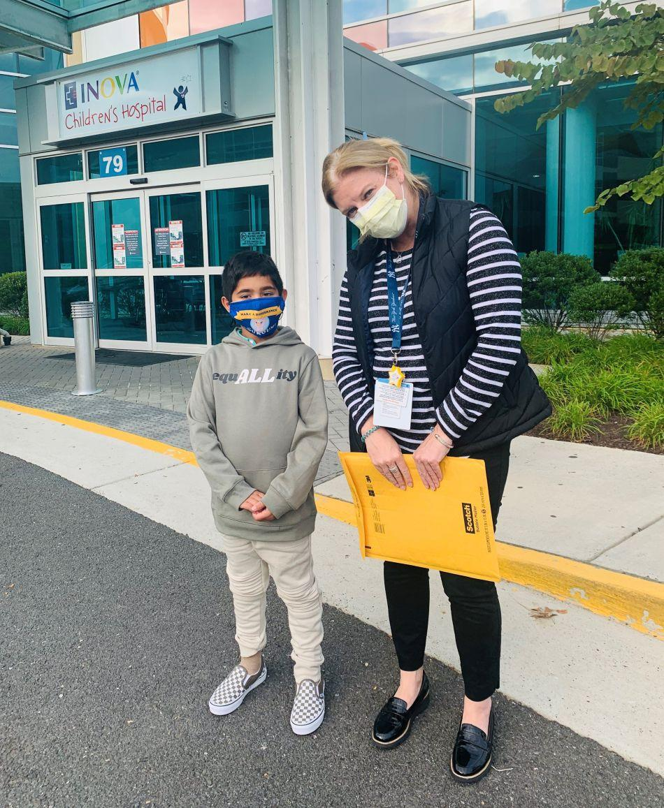 Zohaib Begg, a third-grader from Ashburn, meets with Kristin McArthur, director of philanthropy for Inova Children's Hospital. (Courtesy of Isma Zubair)