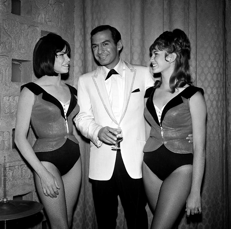 """FILE - In this 1965 file photo, actor Ben Gazzara poses with dancers Sandy Garrett, left, and Victoria Scruton while filming an episode of the TV series """"Run for Your Life,"""" in Los Angeles. Gazzara, whose powerful dramatic performances brought an intensity to a variety of roles and made him a memorable presence in films, on television and on Broadway in the original """"Cat on a Hot Tin Roof,"""" has died at age 81. Longtime family friend Suzanne Mados said Gazzara died Friday, Feb. 3, 2012, in Manhattan after being in hospice care with cancer. (AP Photo, file)"""