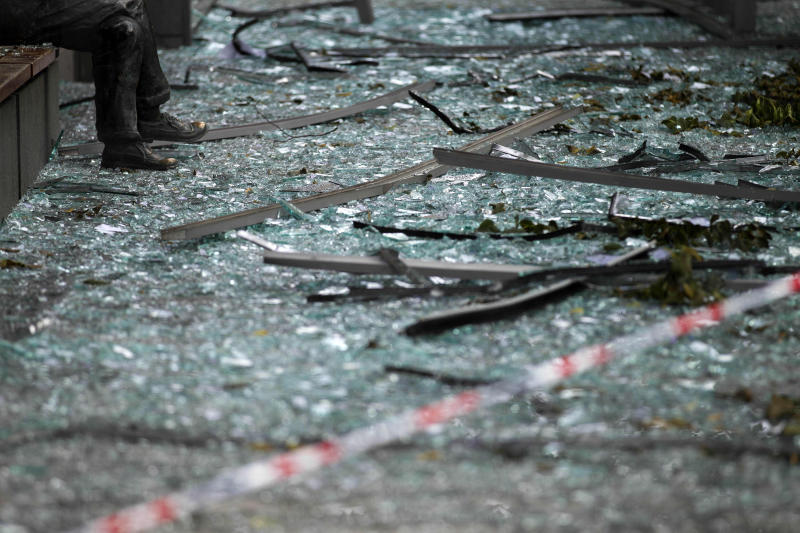 FILE - In this July 26, 2011, file photo, the legs of a statue are surrounded by broken glass and debris inside a cordoned off area damaged by a bombing attack in Oslo several days earlier. The attacker, Anders Behring Breivik, raged against Europe's growing Muslim population and claimed to represent what turned out to be an imagined order of Knight crusaders. The March 2019 attack in Christchurch, New Zealand, has drawn comparisons to the attack in Norway. (AP Photo/Matt Dunham, File)