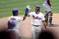 Philadelphia Phillies' Matt Vierling, right, high fives Jean Segura after Vierling hit a solo home run off Pittsburgh Pirates starting pitcher Wil Crowe during the third inning of a baseball game, Saturday, Sept. 25, 2021, in Philadelphia. (AP Photo/Derik Hamilton)