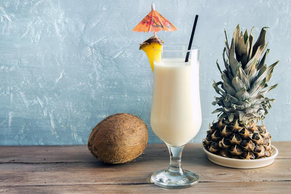"""This rich poolside drink can be made with a variety of rums—or try layering in a combination of the bottles you have for more complex flavor. <a href=""""https://www.epicurious.com/recipes/food/views/pina-colada-51171430?mbid=synd_yahoo_rss"""" rel=""""nofollow noopener"""" target=""""_blank"""" data-ylk=""""slk:See recipe."""" class=""""link rapid-noclick-resp"""">See recipe.</a>"""