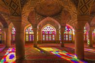 <p>At first glance, the Nasir al-Mulk Mosque appears to be in the same traditional style as the other incredible mosques in Shiraz. However, a step inside reveals a dazzling world of color and patterns waiting to be discovered. Nicknamed the Pink Mosque, Nasir al-Mulk boasts an impressive display of Persian stained-glass windows that blanket the prayer room and rose-tiled arabesque arches in a rainbow of shades. The best time to see the rainbow effect is in the early morning hours.</p>