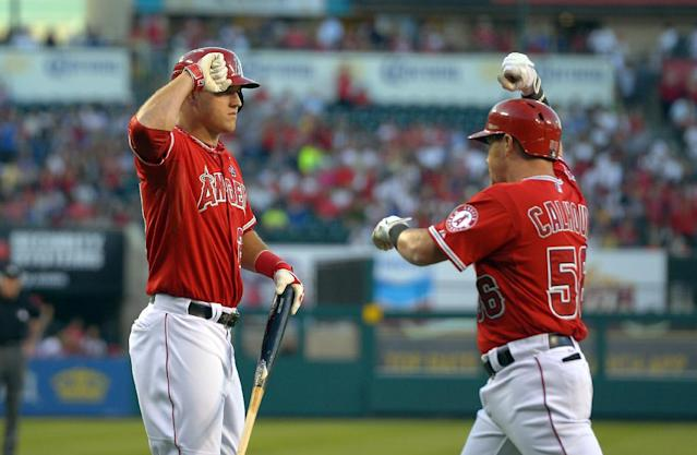 Los Angeles Angels' Mike Trout, left, congratulates Kole Calhoun after he hit a solo home run during the first inning of their baseball game, Tuesday, Aug. 6, 2013, in Anaheim, Calif. (AP Photo/Mark J. Terrill)