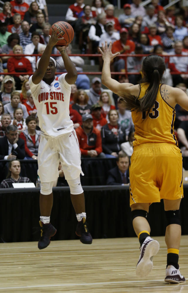 Ohio State guard Linnae Harper, left, shoots against Central Michigan forward Reyna Frost during the first half of a second-round game in the NCAA women's college basketball tournament in Columbus, Ohio, Monday, March 19, 2018. (AP Photo/Paul Vernon)
