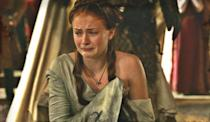 <p>Season 2 also marks the beginning of Sansa's physical abuse, along with the escalation of her emotional abuse. In one memorably horrible moment, she's beaten and her clothes are ripped from her body in court. If Sansa's clothes have been her armor and her way to hide, this moment proves that hiding won't be enough. She'll have to learn to play the game. </p>